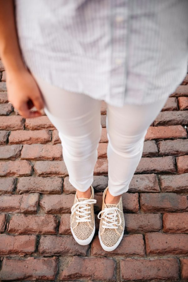 Chicago-based fashion blogger Bows & Sequins wearing Old Navy white denim pants and print-mixing leopard-printed sneakers and a striped chambray top.