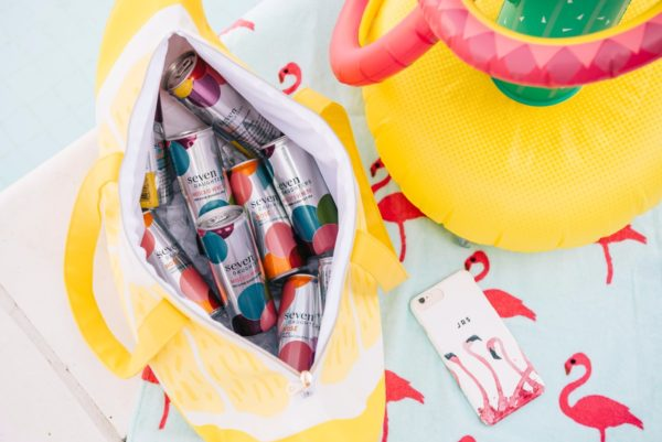 Bows & Sequins throws a summer pool party with Seven Daughters wine cans.