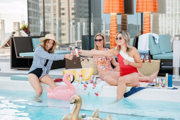 Bows and Sequins throws a rooftop pool party with Seven Daughters wine cans.