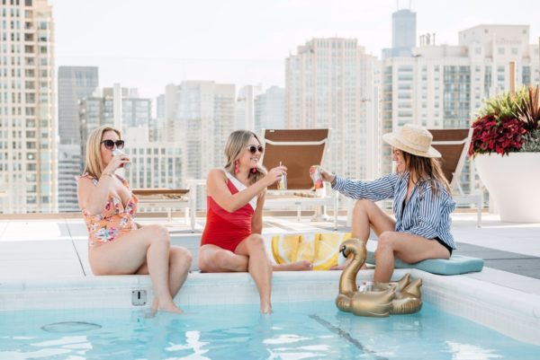 Chicago fashion and lifestyle bloggers throwing an end of summer celebration pool party with Seven Daughters.