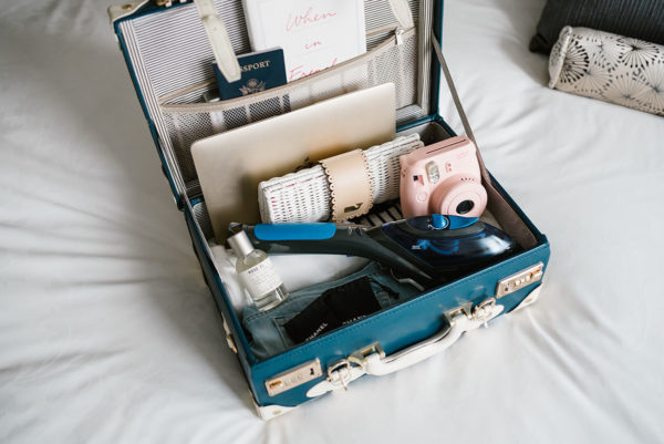 Travel writer Bows & Sequins using a carry on travel iron.