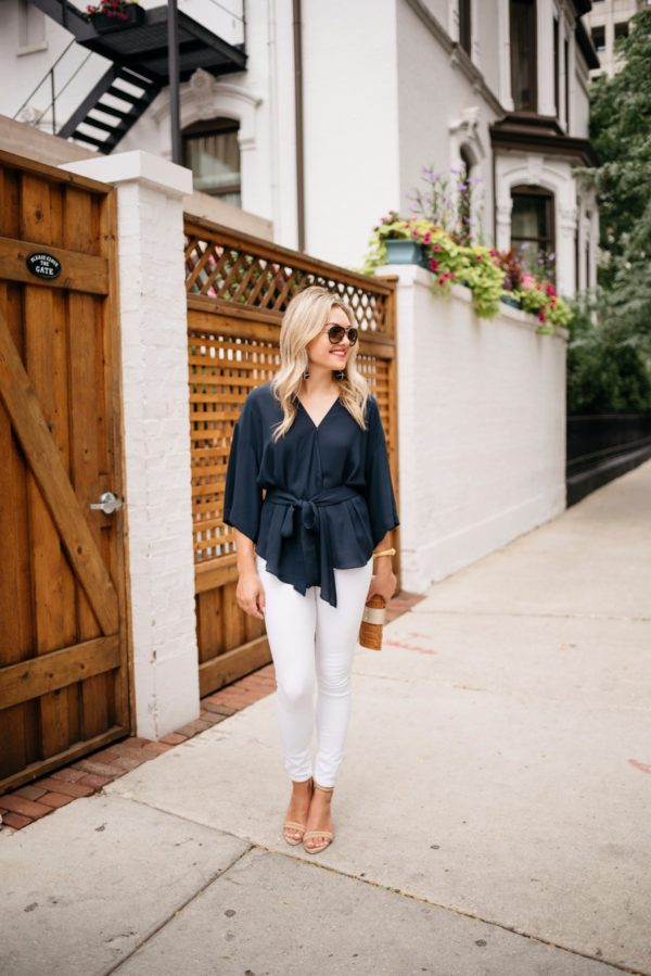 Fashion-focused lifestyle blogger Bows & Sequins wearing Celine aviators, a navy Trouve blouse, Old Navy white denim, Kenneth Cole ankle strap heels, and a Julie Vos gold cuff with a Vineyard Vines wicker clutch.