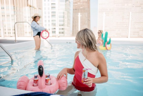 Bows & Sequins hosting a pool party with a flamingo beer float.
