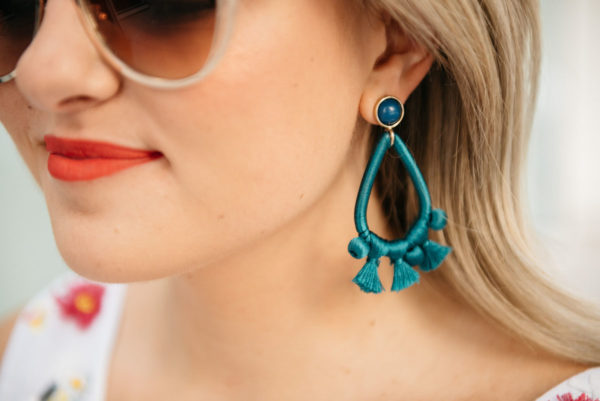 Bows & Sequins wearing teal Sardina earrings from BaubleBar.