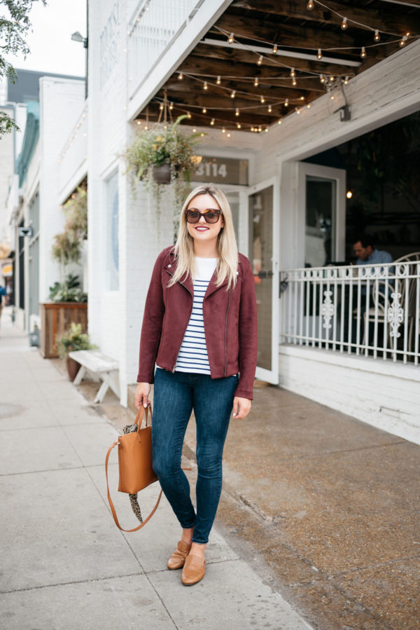 Bows & Sequins wearing a burgundy suede jacket, Old Navy Rockstar jeans, and a leather bag.