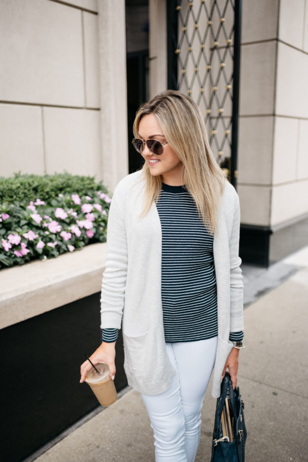 Bows & Sequins wearing an Old Navy cardigan, navy striped sweater, and white jeans with Gucci aviators.