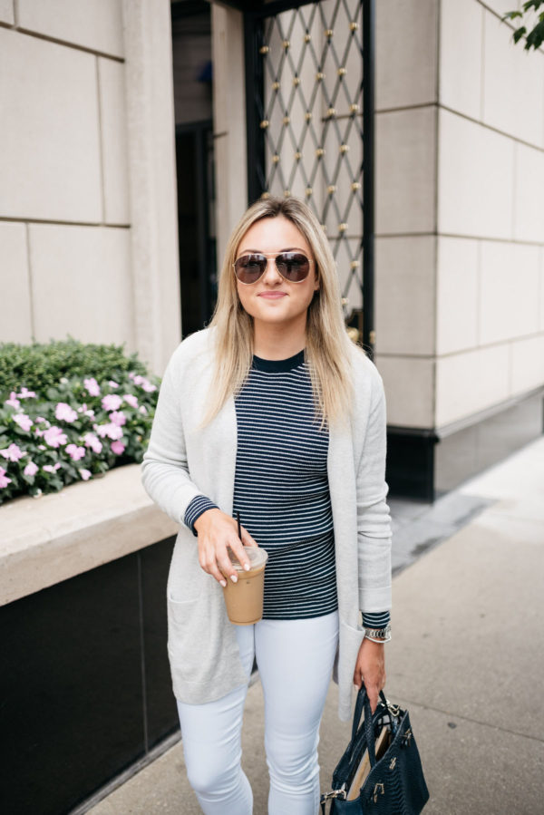 Bows & Sequins wearing Gucci aviators, Old Navy cardigan, navy striped sweater, and white jeans with a David Yurman bracelet and Coach watch.