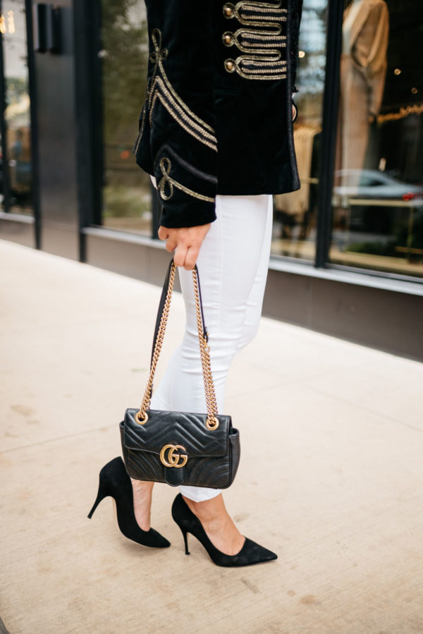 Bows & Sequins wearing a gold detailed velvet blazer with Old Navy white jeans, Kate Spade suede pumps, and a Gucci Marmont bag.
