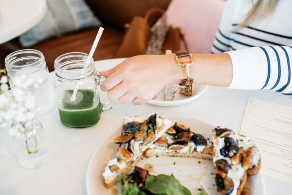 Bows & Sequins wearing a Gucci cuff from Switch at Masion Marcel French Bakery in Chicago.