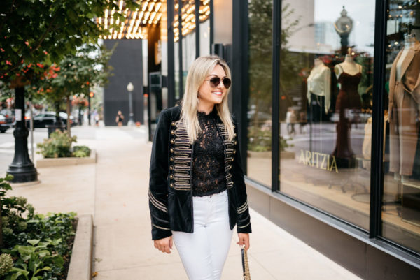 Chicago-based fashion blogger Bows & Sequins wearing Gucci aviator sunglasses, a Blank NYC velvet blazer, Zara lace top, and Old Navy white jeans.