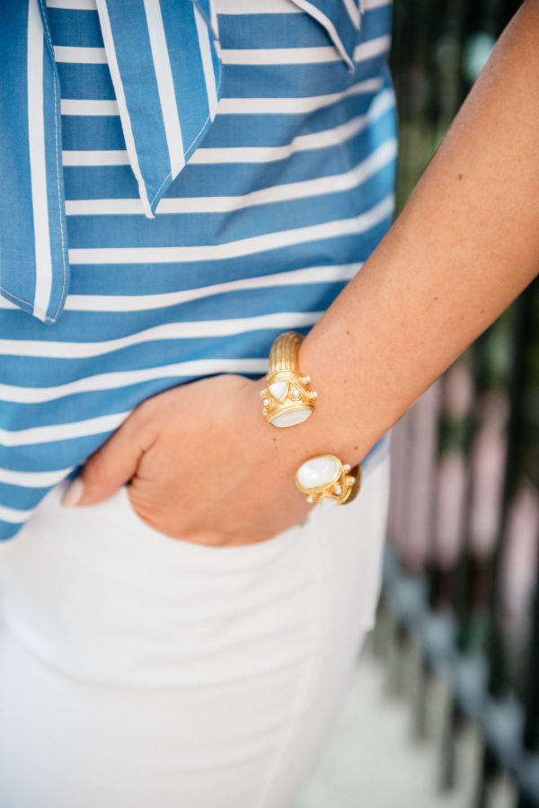 Bows & Sequins wearing a blue and white striped top and white denim with a gold Julie Vos cuff.