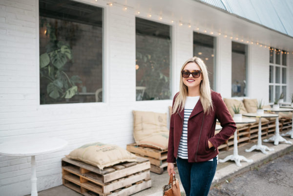 Chicago fashion and lifestyle blogger Bows & Sequins wearing a burgundy suede moto jacket, Old Navy striped shirt, and Celine sunglasses at Maison Marcel french bakery.