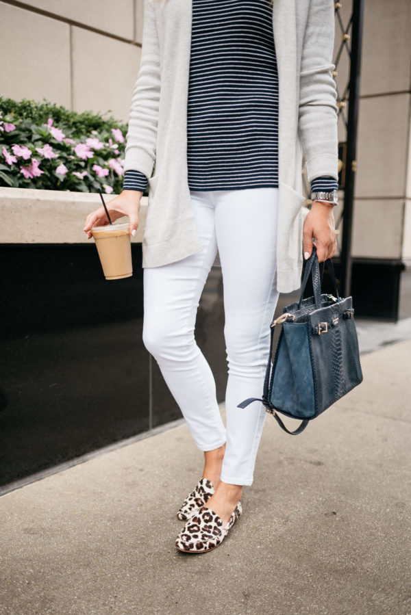 Chicago blogger Bows & Sequins wearing Old Navy white jeans, Kate Spade leopard loafers, a navy striped sweater, and a cardigan with a navy Kate Spade tote.