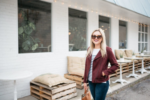 Chicago lifestyle blogger Bows & Sequins wearing a burgandy moto jacket and striped shirt from Old Navy with Celine sunglasses and Bare Minerals matte lipstick in Devious.