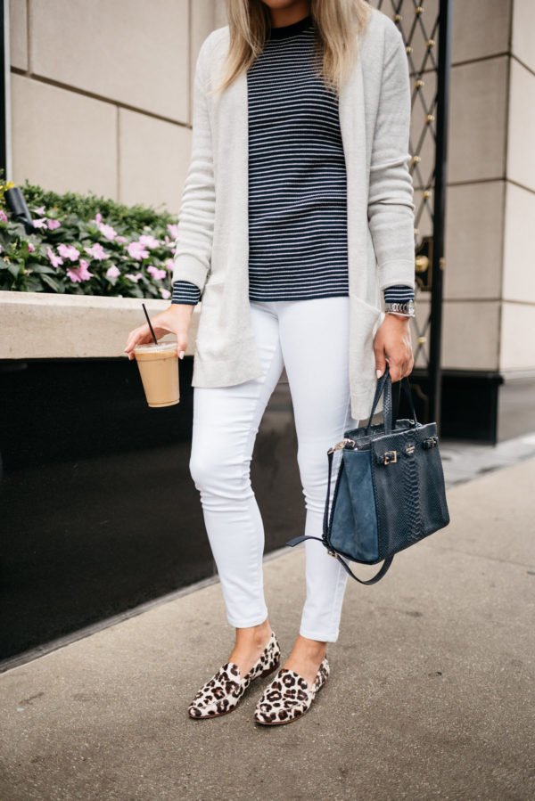 Bows & Sequins wearing an Old Navy cardigan, striped sweater, white jeans, and Kate Spade leopard loafers with a navy tote, David Yurman bracelet and a Coach stainless steel watch.