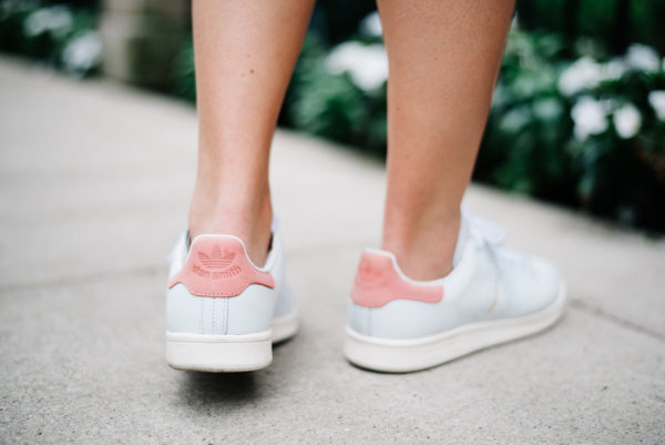 Bows & Sequins wearing pink Stan Smith sneakers.