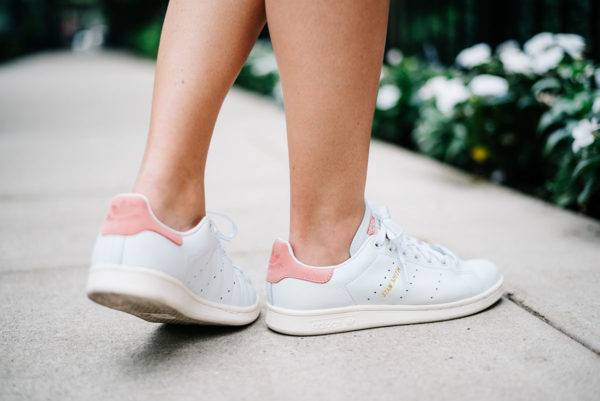 Bows & Sequins wearing white and pink Adidas Stan Smith sneakers.