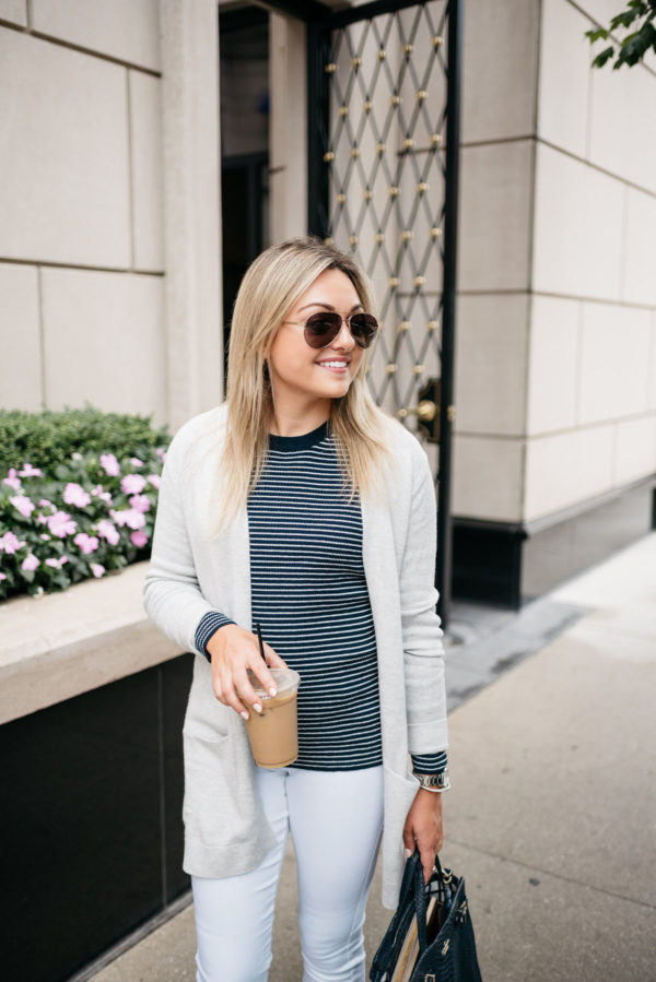 Chicago fashion and lifestyle blogger Bows & Sequins wearing Gucci aviators, an Old Navy cardigan, navy striped sweater, and white denim with a David Yurman bracelet.