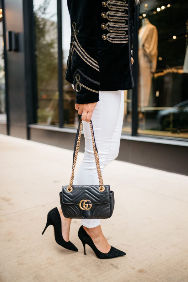 Bows & Sequins wearing Old Navy white jeans, Kate Spade suede pumps, and a velvet blazer with a Gucci Marmont bag.
