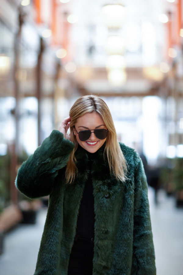 Bows & Sequins wearing a green faux fur coat in London.