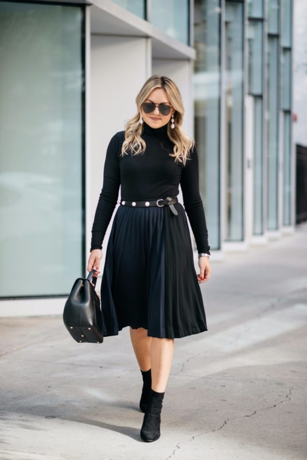 Chicago fashion and lifestyle blogger Bows & Sequins wearing a J.Crew ribbed turtleneck bodysuit, a Claudie Pierlot pearl studded belt, Le Specs aviators, a Leith navy and black pleated skirt, and Steve Madden ankle booties with a Polene bag.