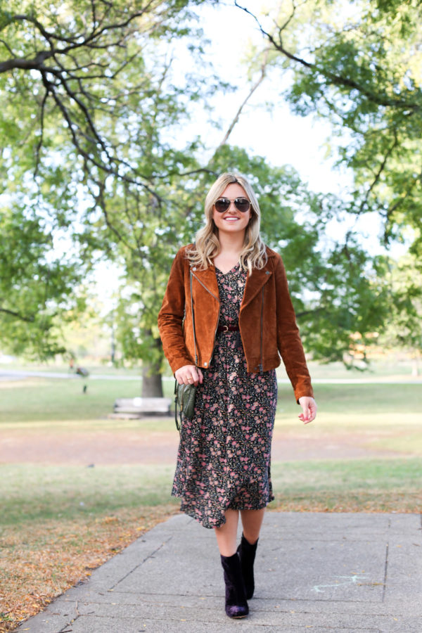 Chicago lifestyle blogger Bows & Sequins wearing a cognac suede jacket, a floral Old Navy dress, and Marc Fisher purple velvet booties.