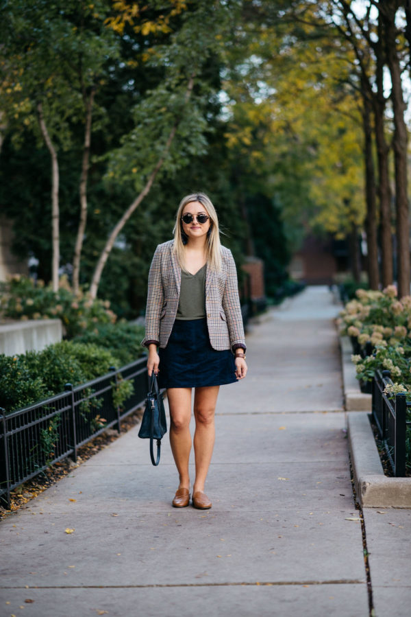 Chicago lifestyle blogger Bows & Sequins styling work wear: Joules houndstooth blazer, Express olive green v-neck tee, Old Navy blue suede skirt, and Dune London leather loafers with a Kate Spade bag.