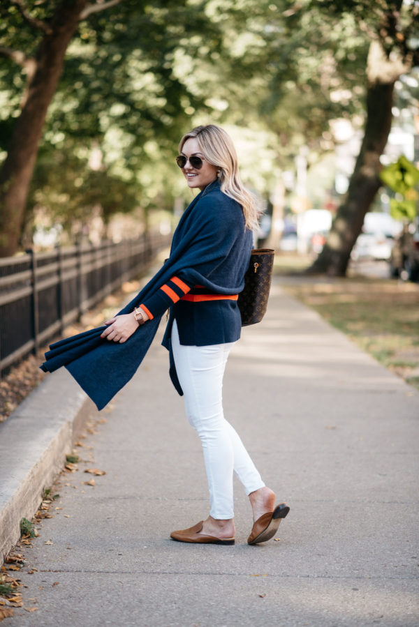 Fashion and lifestyle blogger Bows & Sequins wearing a navy blue cashmere wrap and Old Navy white jeans with Dune London leather loafers and Gucci aviators.