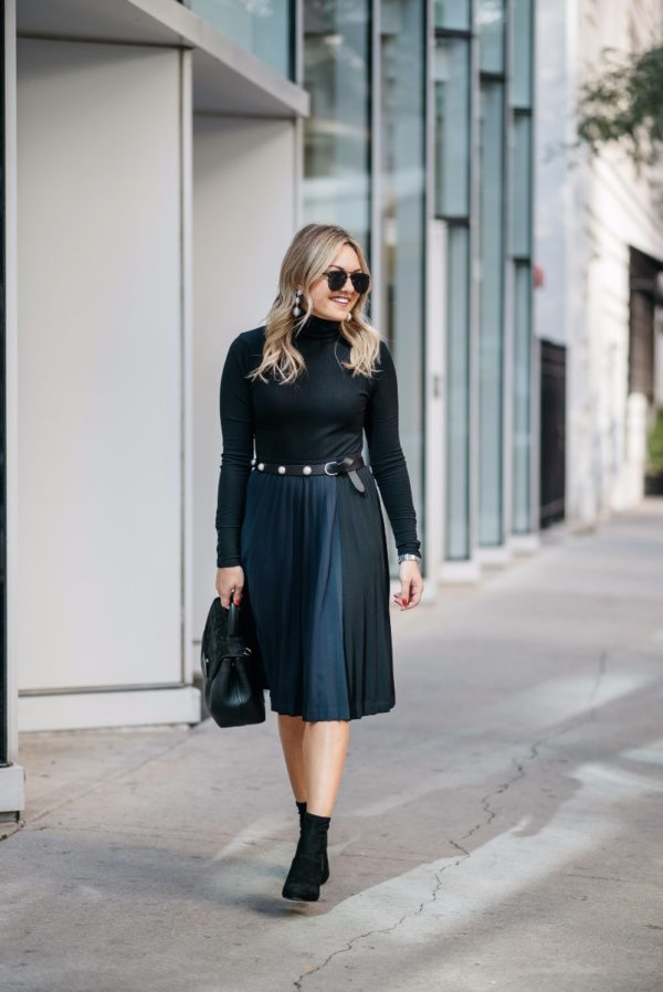 Bows & Sequins wearing Baublebar silver ball earrings, a J.Crew turtleneck, navy and black pleated skirt, lucite ankle boots, and a pearl studded belt with a Polene top-handle bag.