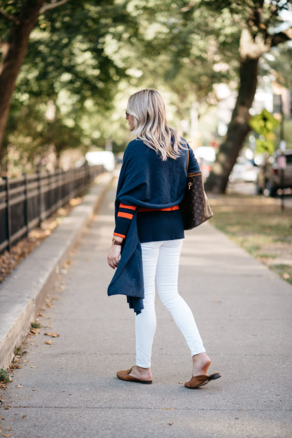 Bows & Sequins styling a navy blue cashmere wrap with white denim and Dune London leather loafers.