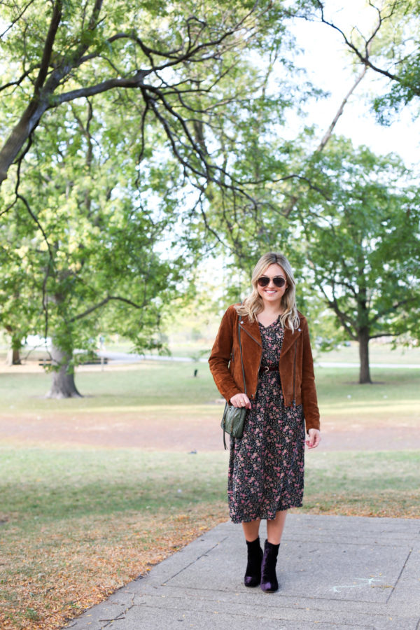 Chicago style blogger Bows & Sequins wearing a cognac suede jacket, an Old Navy floral dress, and purple velvet Marc Fisher booties.