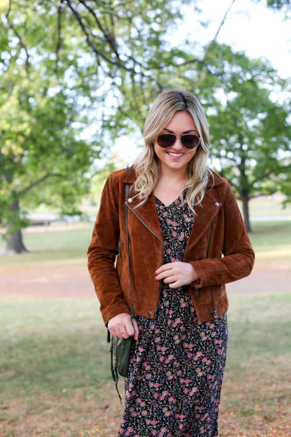 Bows & Sequins wearing a suede jacket with a floral midi dress and a green leather shoulder bag.