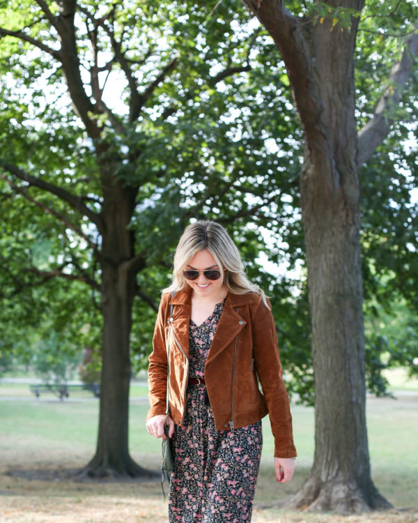 Fashion and travel writer Bows & Sequins styling a Blank NYC cognac suede jacket with an Old Navy floral dress and aviators for fall.