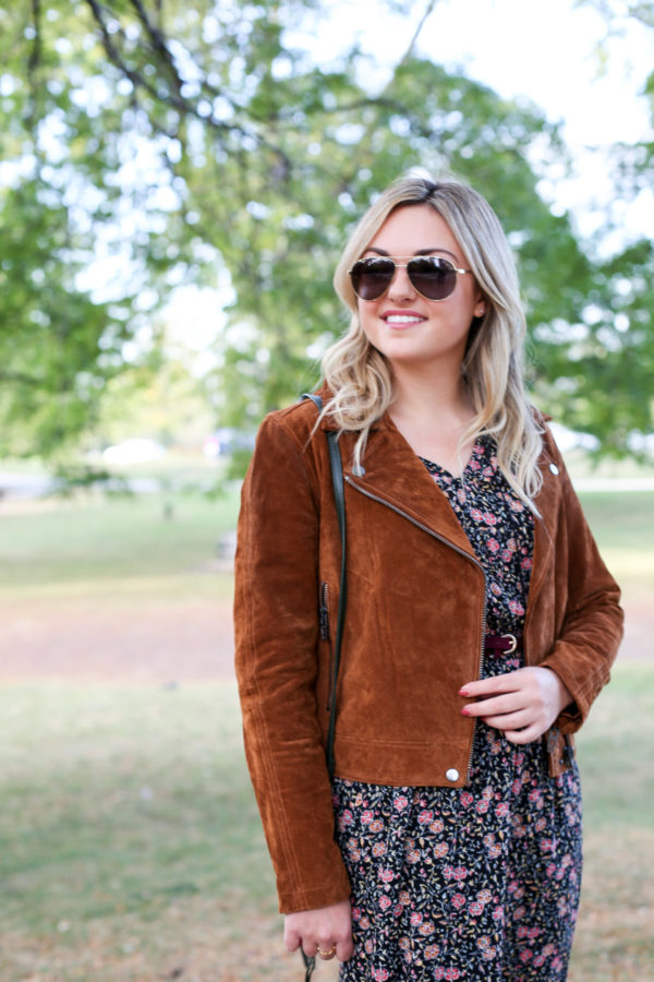 Bows & Sequins styling a cognac suede jacket and floral dress.