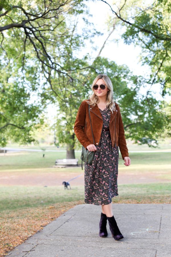 Jessica from Bows & Sequins wearing a Blank NYC cognac suede jacket, an Old Navy floral midi dress, a Joelle Hawkens green leather shoulder bag, Marc Fisher purple velvet booties and aviators.