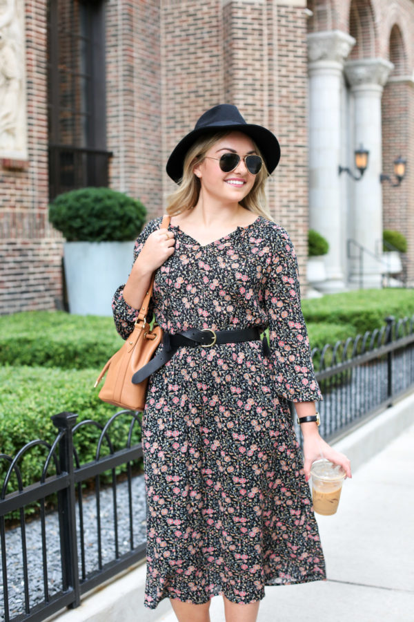 Bows & Sequins wearing a floral Old Navy midi dress with black accessories.