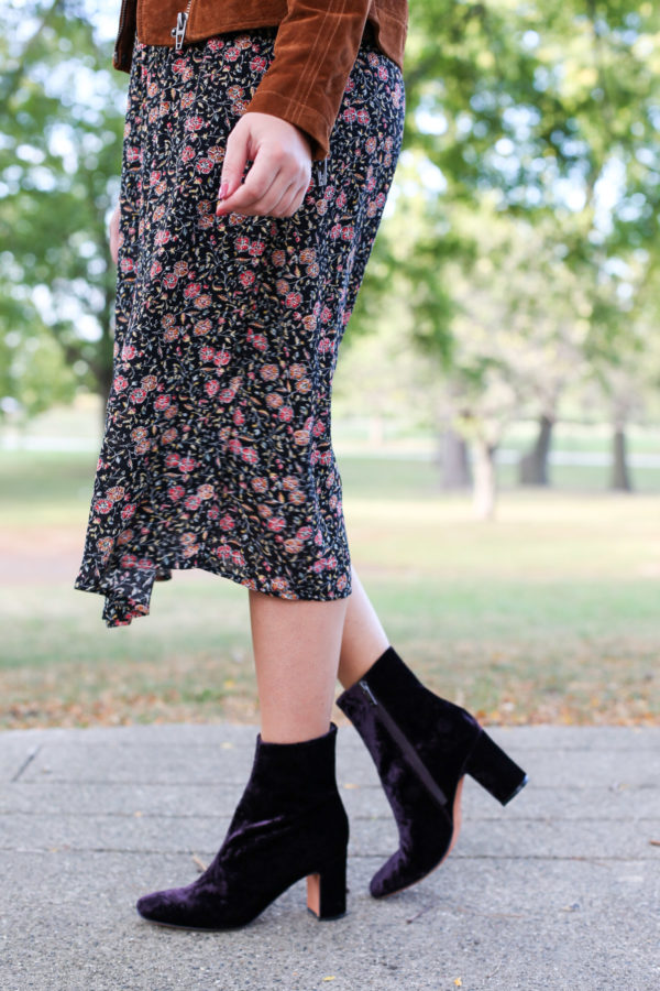 Bows & Sequins wearing a floral midi dress and Marc Fisher purple velvet booties.