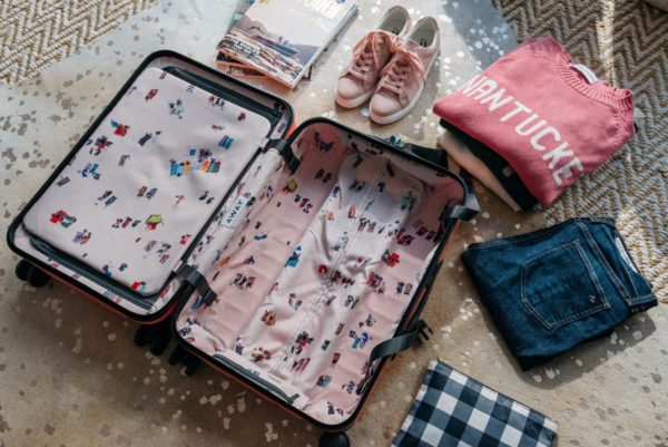 Bows & Sequins sharing packing tips for a carry on suitcase.