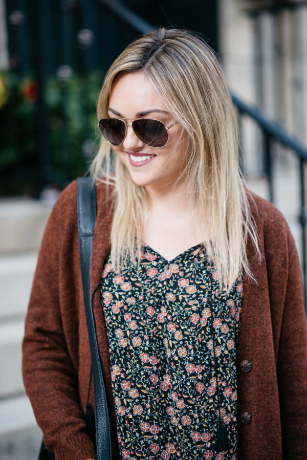 Chicago fashion blogger Bows & Sequins wearing Gucci aviators, an Old Navy cardigan and floral blouse with NARS Audacious lipstick in 'Anna'.