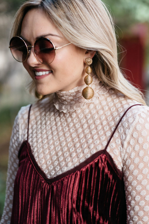 Fashion blogger Bows & Sequins wearing a Zara sheer lace turtleneck and a Massimo Dutti velvet cami with round tortoise sunglasses and gold Tuckernuck earrings.