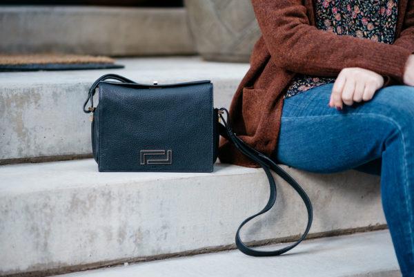 Bows & Sequins styling a Lancel black Pia bag.