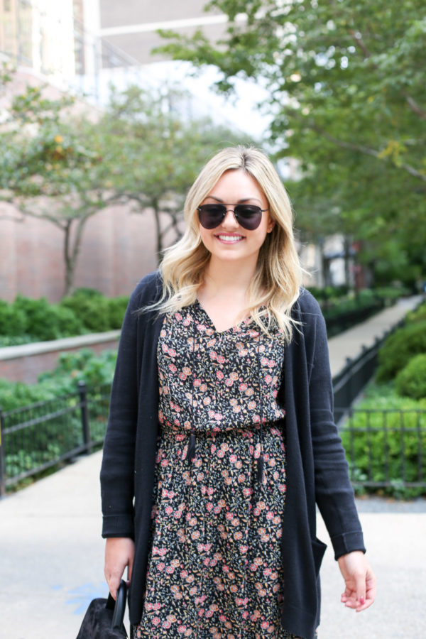 Bows & Sequins wearing Le Specs matte aviators, an Old Navy cardigan, floral dress, and a black leather belt.
