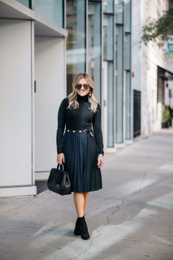 Chicago fashion blogger Bows & Sequins wearing a J.Crew ribbed turtleneck bodysuit with a Leith navy and black pleated skirt, a pearl studded belt, Steve Madden lucite ankle booties, and a Polene top-handle bag.