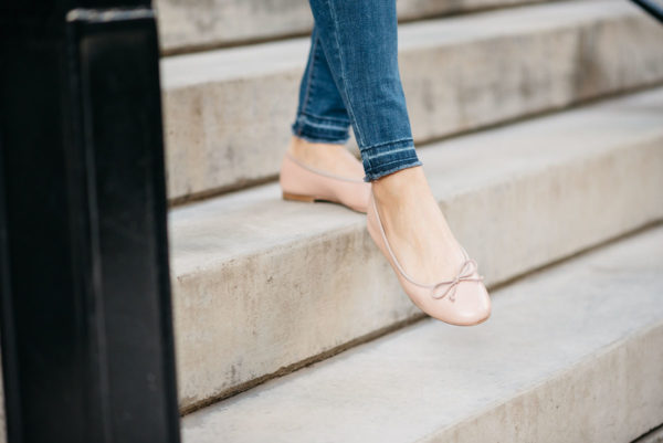 Bows & Sequins wearing raw hem Old Navy jeans with pink Margaux Ballerina ballet flats.