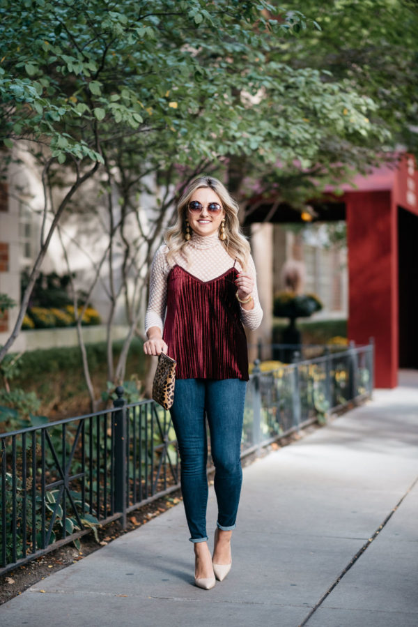 Chicago-based fashion blogger Bows & Sequins wearing retro tortoise sunglasses, a Zara sheer lace turtleneck, a Massimo Dutto red velvet cami, Old Navy Rockstar skinny jeans, Kate Spade pumps, and Tuckernuck gold earrings with a Clare V leopard clutch.