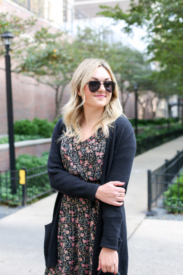 Bows & Sequins wearing matte aviators, a black cardigan, and an Old Navy floral midi dress.