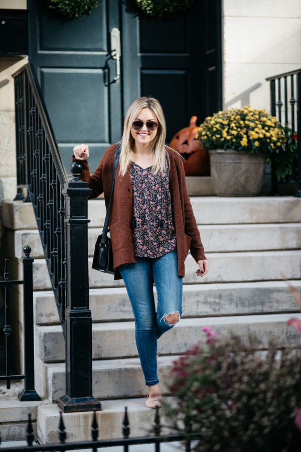 Bows & Sequins wearing Gucci aviators, an Old Navy slouchy cardigan, a floral blouse, raw hem distressed jeans, and Margaux ballet flats with a Lancel black Pia bag.