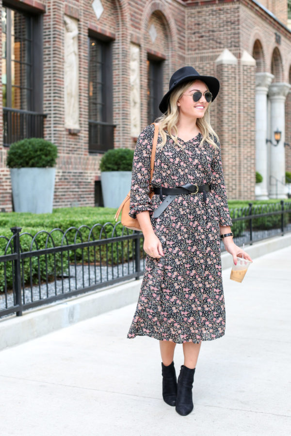 Bows & Sequins wearing an Old Navy fall floral midi dress with a Madewell leather belt, black hat, a Kate Spade watch, and ankle booties.