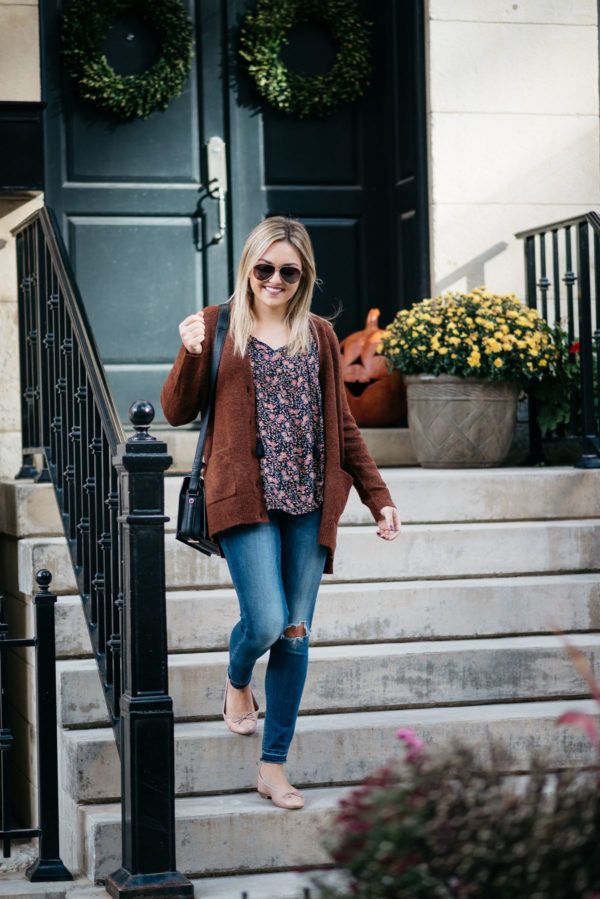 Chicago-based fashion-focused blogger Bows & Sequins wearing Gucci aviators, a slouchy sweater, an Old Navy floral blouse, Old Navy Rockstar jeans, Margaux Ballerina ballet flats, and a Lancel black Pia bag with NARS Audacious lipstick in 'Anna'.