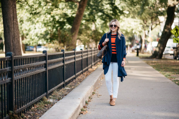 Chicago blogger Bows & Sequins wearing a navy blue cashmere wrap with Old Navy white denim and Dune London leather loafers.
